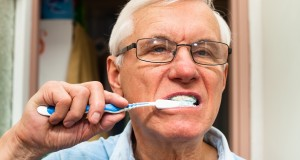 Senior man brushing his teeth