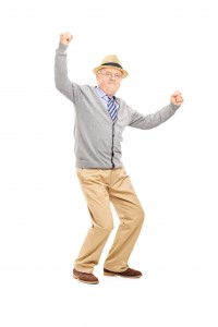 Full length portrait of an old man gesturing happiness